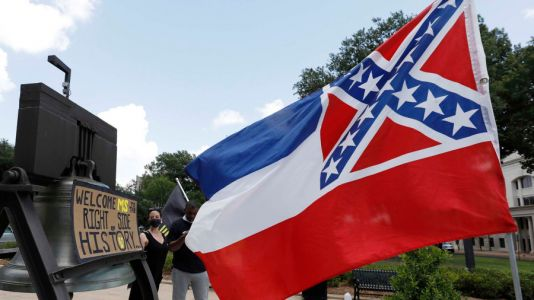 WATCH: Mississippi's Republican Governor Signs Law Removing Confederate Symbol from State Flag