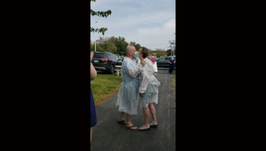 Couple marries in parking lot so father can attend