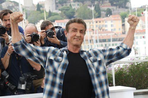 Sylvester Stallone keeps wearing flannel shirts and jeans on the Cannes red carpet