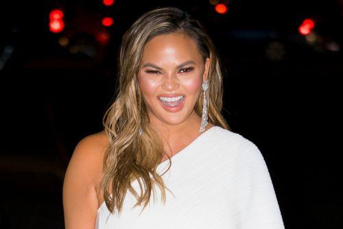Chrissy Teigen's dad got a tattoo of her face