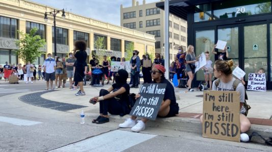 LIVE: People gather in Grand Rapids for silent protest