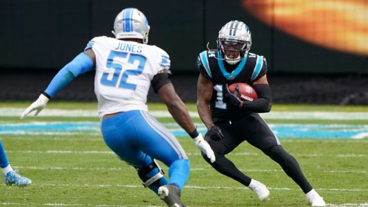 Walker wins first NFL start as Panthers blank Lions