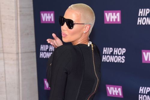 Amber Rose shows off her derrière in pink lace while promoting OnlyFans account