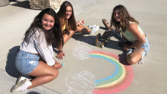 Group of teens working to build community by breaking a world record