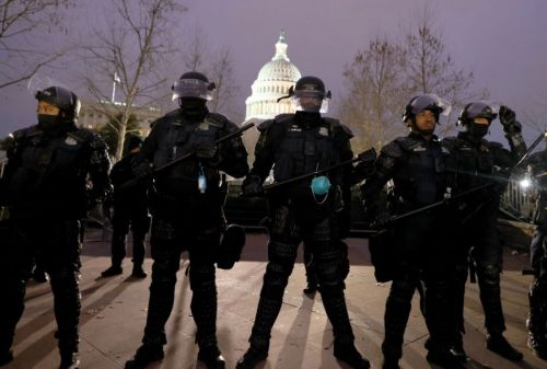 More than a dozen Capitol officers sick with COVID-19, report says