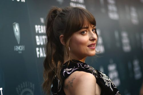 Dakota Johnson reveals she has '11 or 12' tattoos