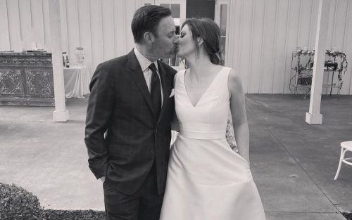 'The Bachelor' host Chris Harrison and Lauren Zima deny they're married after wedding-like Instagram photo posting